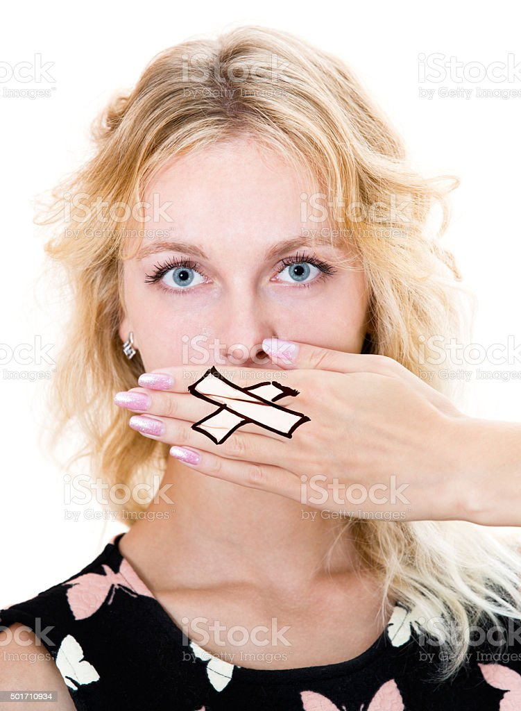 Girl cover her mouth with hand. Silence stock photo