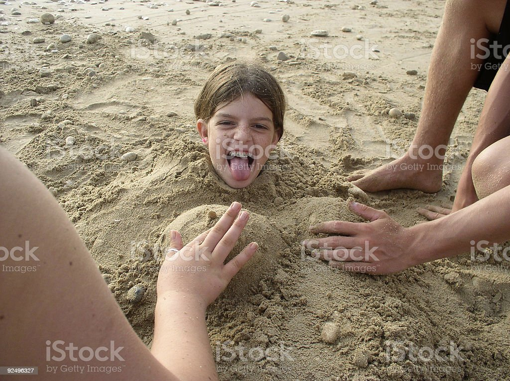 Girl covered with sand royalty-free stock photo