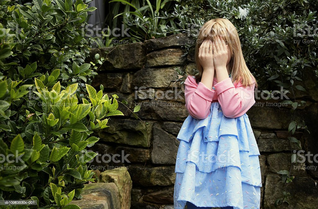 Girl (6-7) covering face royalty-free stock photo
