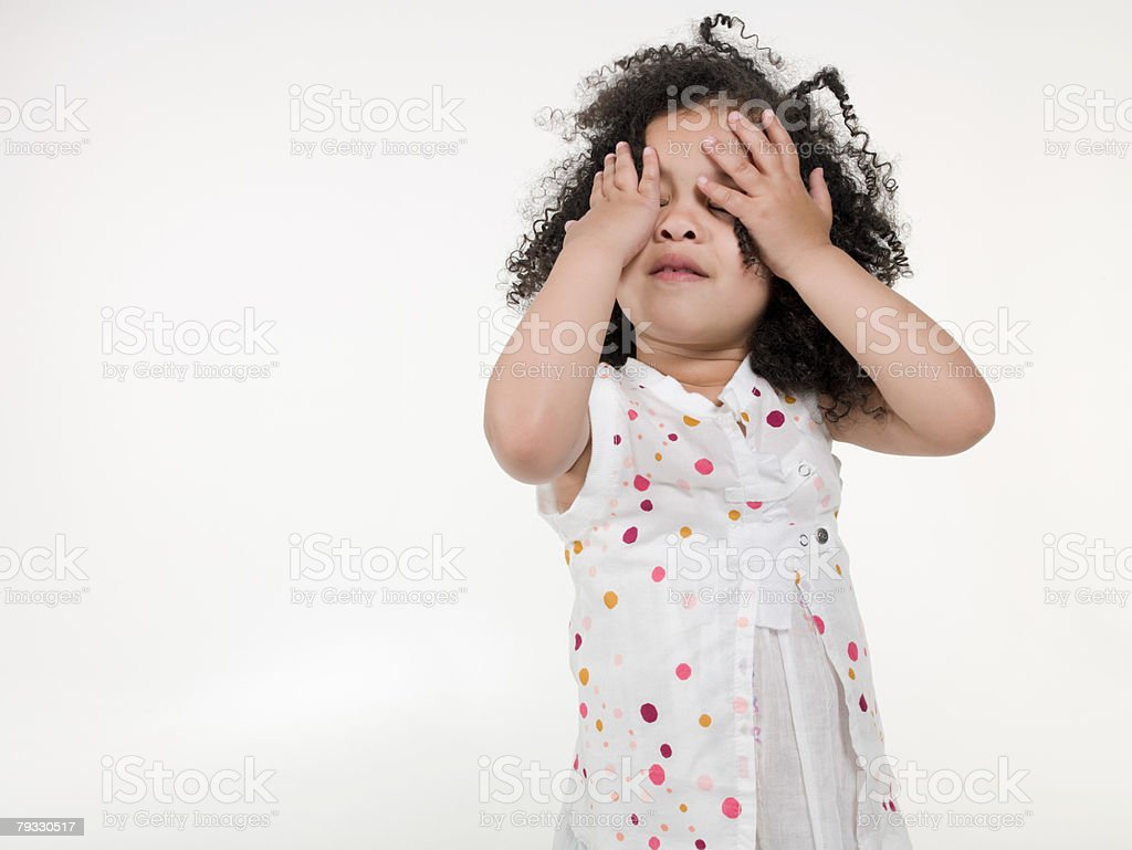 A girl covering her eyes 免版稅 stock photo