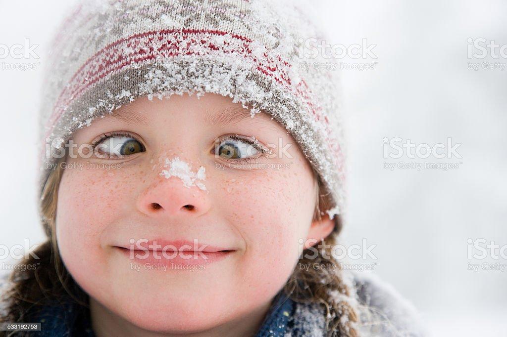 Girl crossing her eyes stock photo
