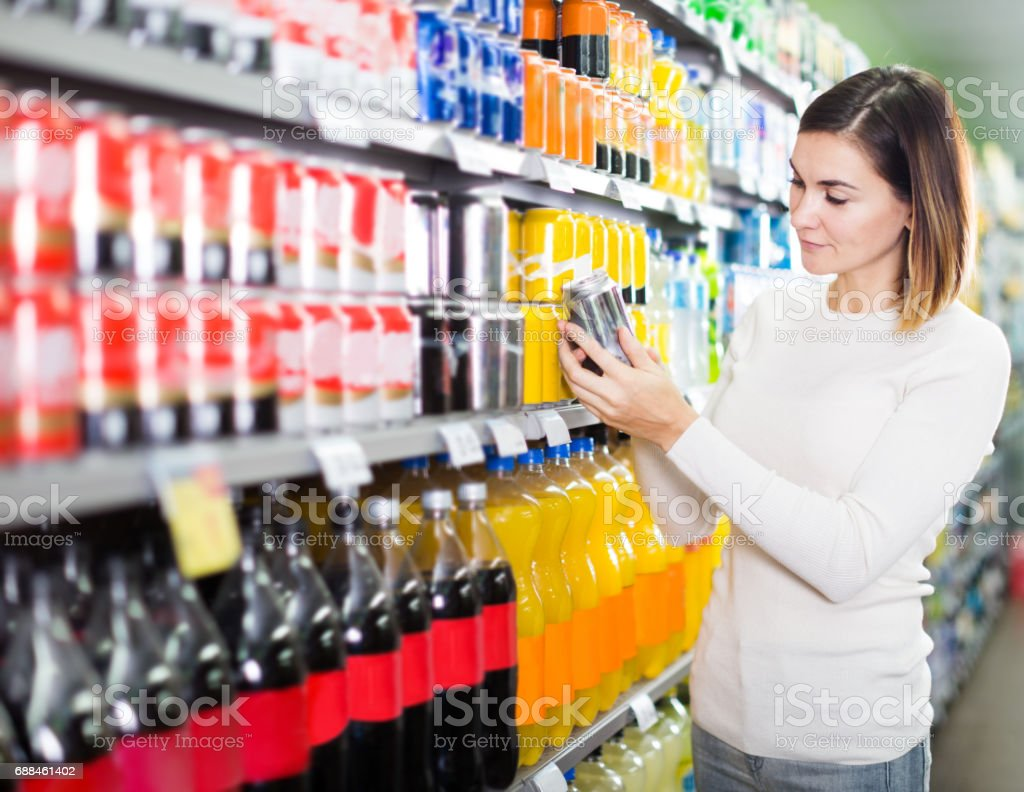 Girl customer looking for refreshing beverages stock photo