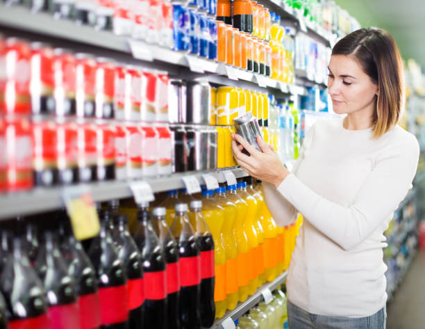 girl customer looking for refreshing beverages - soda pop stock photos and pictures