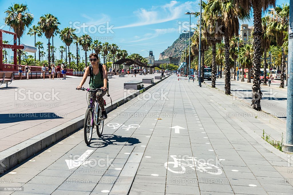 Girl cycling on the promenade in Barcelona - Foto de stock de Adolescente libre de derechos