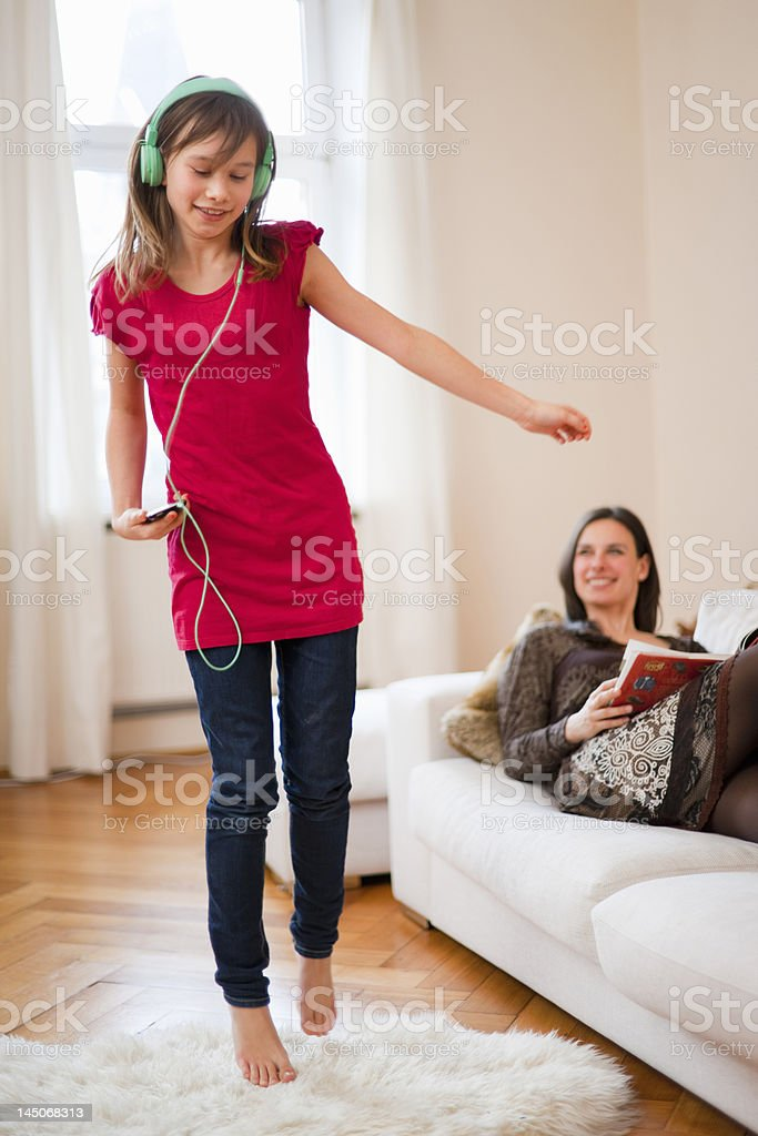 Girl dancing and listening to headphones stock photo