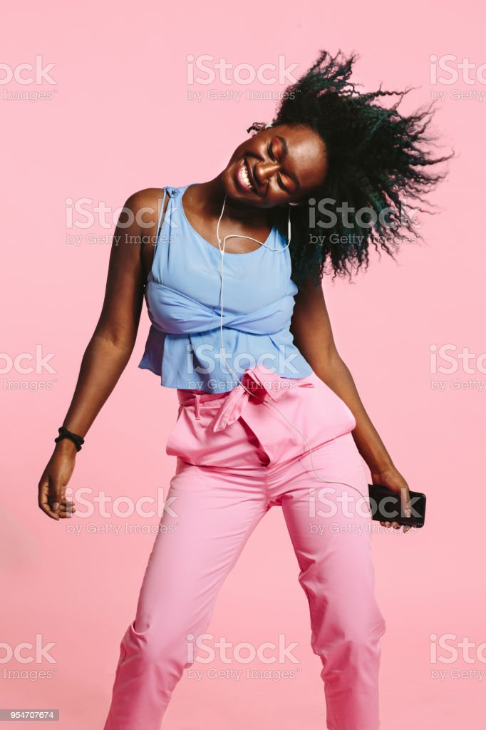 Girl dancing and listening to music on earphones royalty-free stock photo