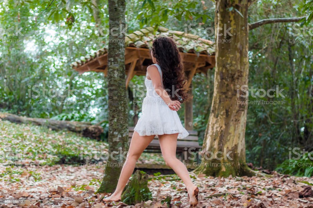 https://media.istockphoto.com/photos/girl-dancing-in-the-woods-picture-id868758812