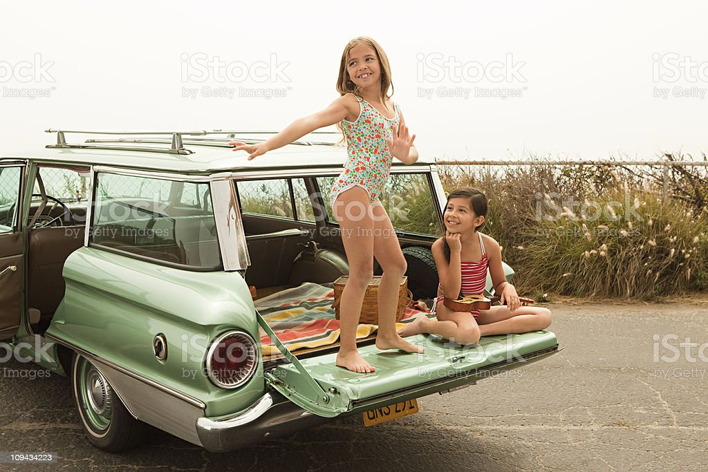 Girl dancing on car boot royalty-free stock photo