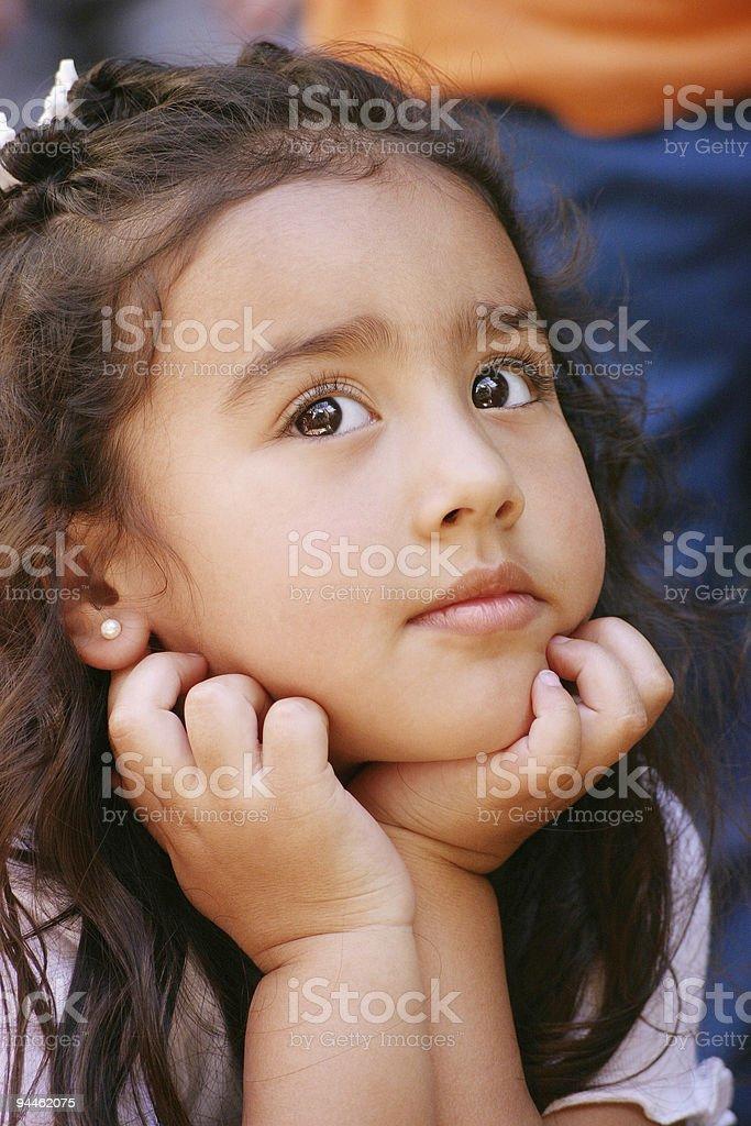 Girl daydreaming stock photo