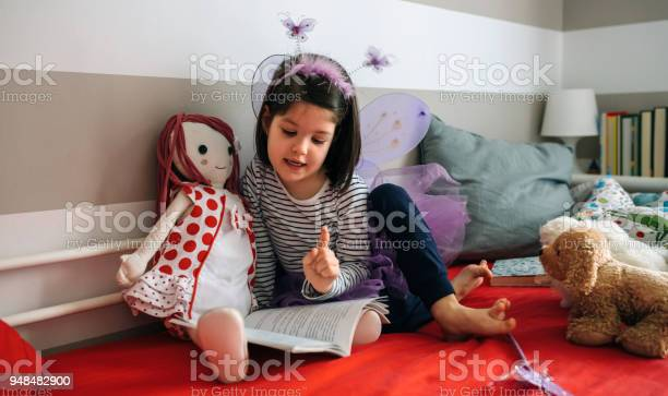 Girl disguised reading a book to her doll picture id948482900?b=1&k=6&m=948482900&s=612x612&h=chrinv2svrxzkpbw4qlzpufcmpj5ld5tptbsr7k bkq=