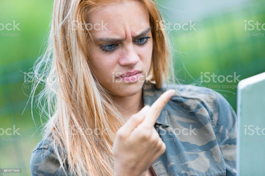 girl disgusted by something on her finger royalty-free stock photo