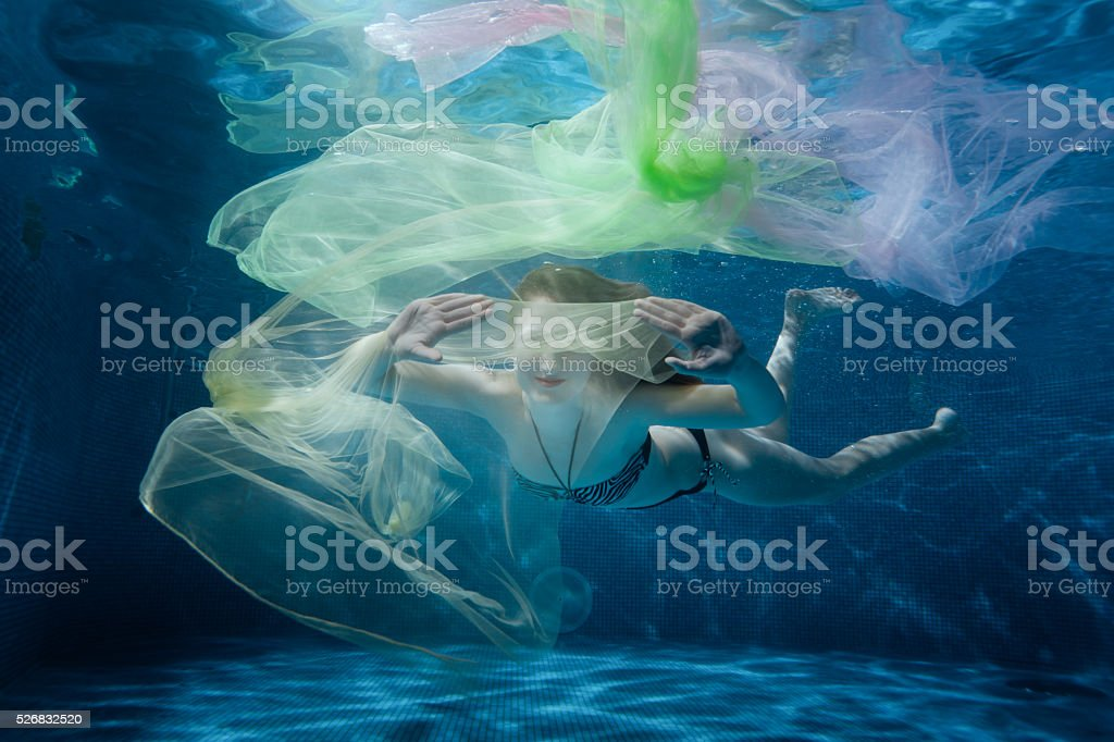 Girl dives into the tissue. stock photo