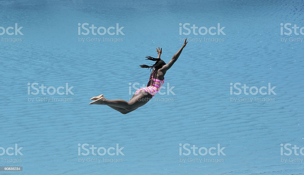 Girl Diving Into Beautiful Blue Water royalty-free stock photo