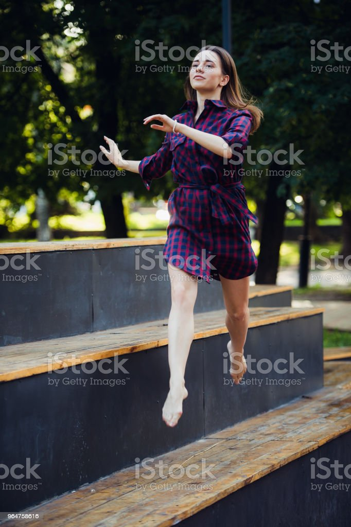 Girl does pirouette walking on a tiptoes against summer park royalty-free stock photo