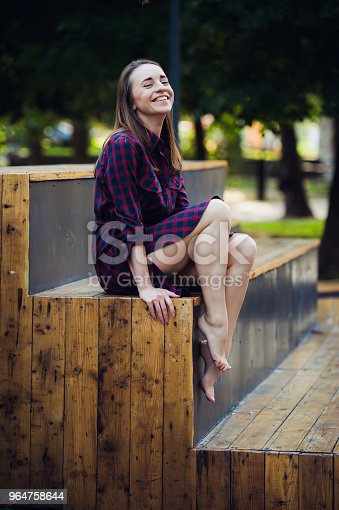 Girl Does Pirouette Walking On A Tiptoes Against Summer Park Stock Photo & More Pictures of Adult