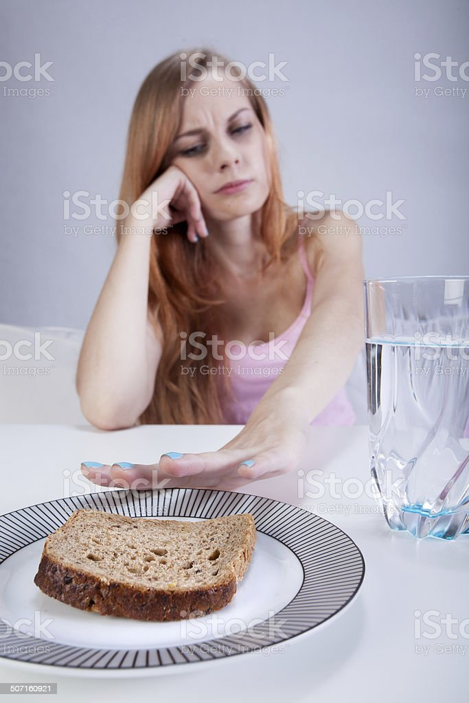 Girl doesn't eat breakfast - Royalty-free Adult Stock Photo