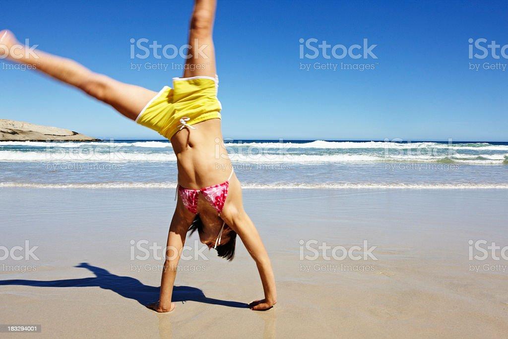 Girl doing a cartwheel royalty-free stock photo