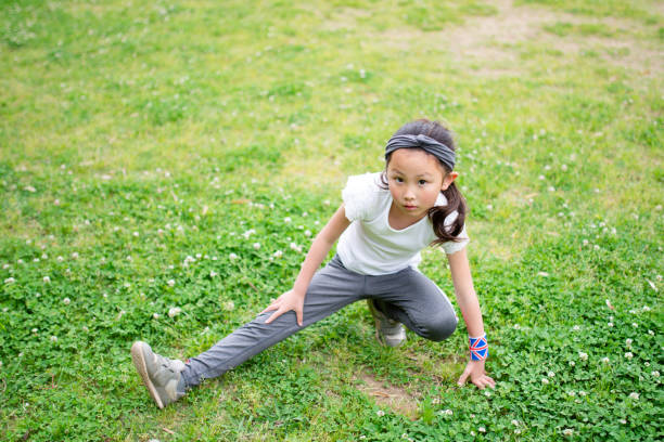 Girl doing a preparatory exercise stock photo