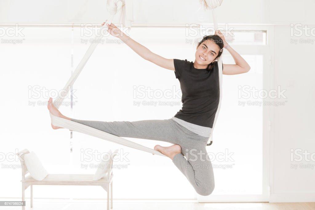 Girl doing aerial yoga stock photo