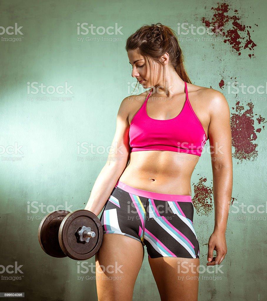 Girl doing biceps curls stock photo