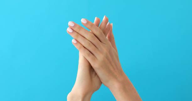 Girl doing claps her hands stock photo