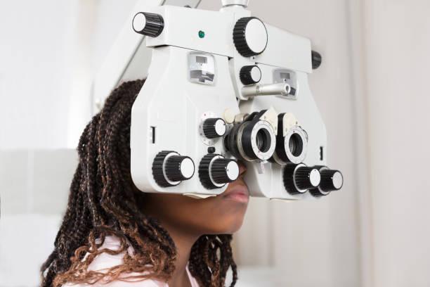 Girl Doing Eye Test stock photo
