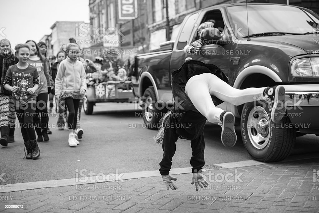 Girl doing flip at Christmas parade in Johnson City, Tennessee royalty-free stock photo
