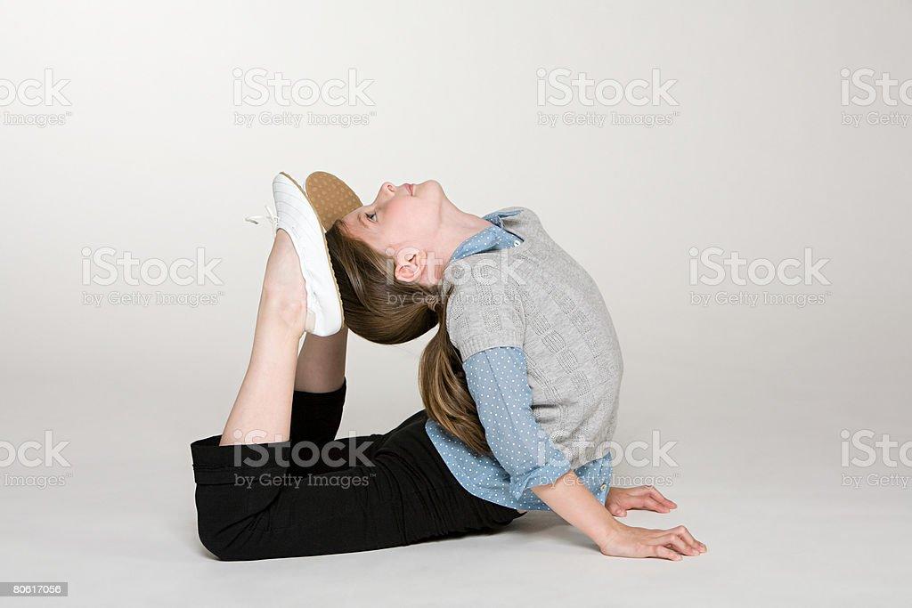 Ein Mädchen tun, Gymnastik Lizenzfreies stock-foto