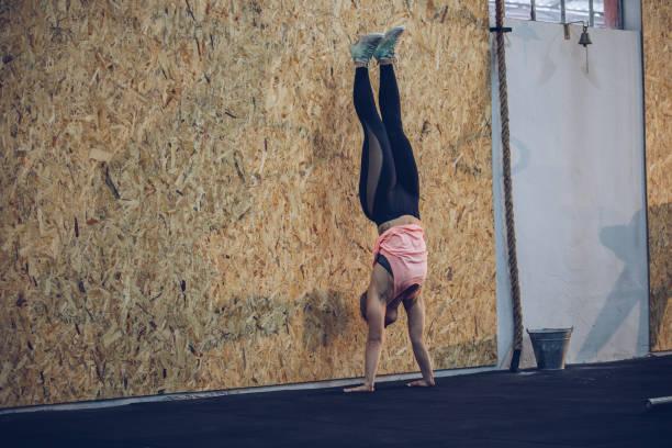 Girl doing handstand stock photo