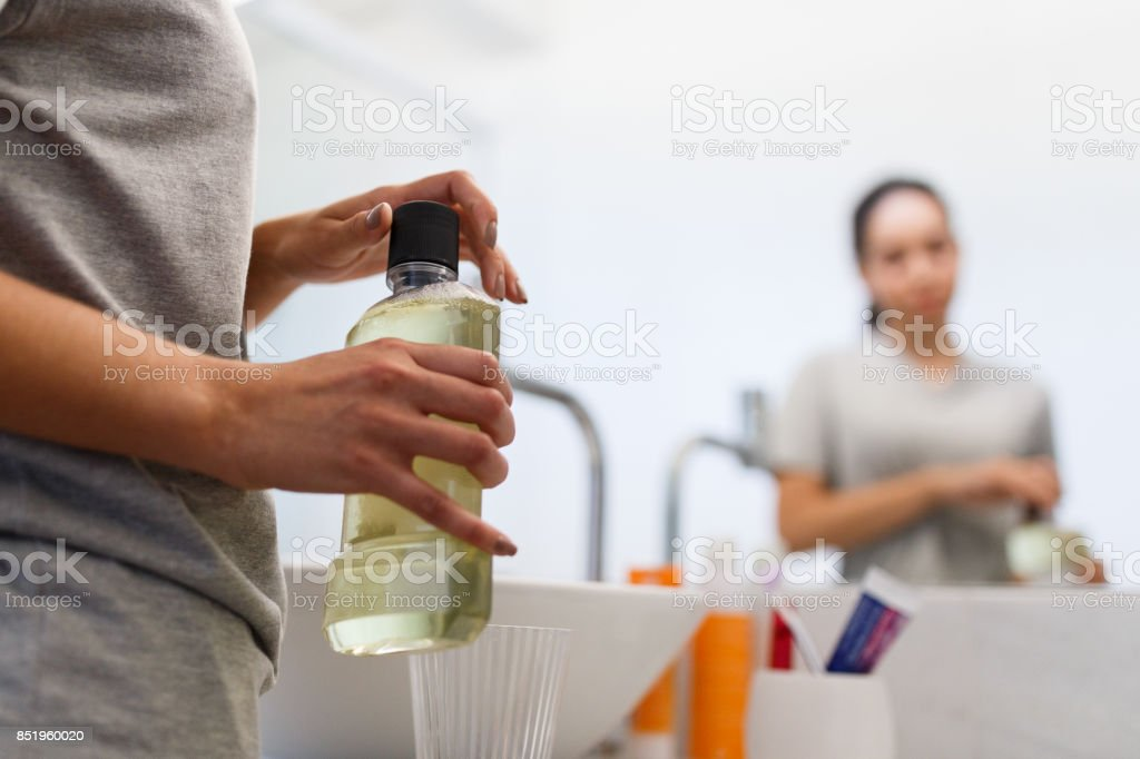 Girl doing her mouth hygiene stock photo