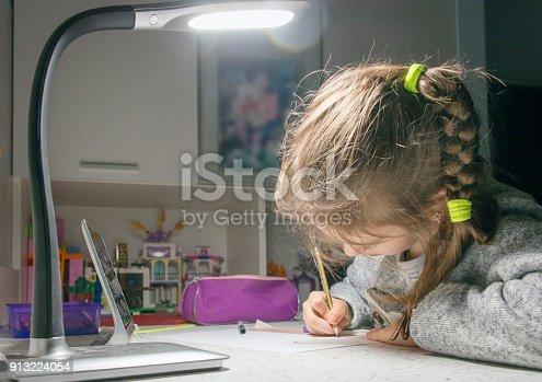 655532196 istock photo Girl doing homework for school. 913224054