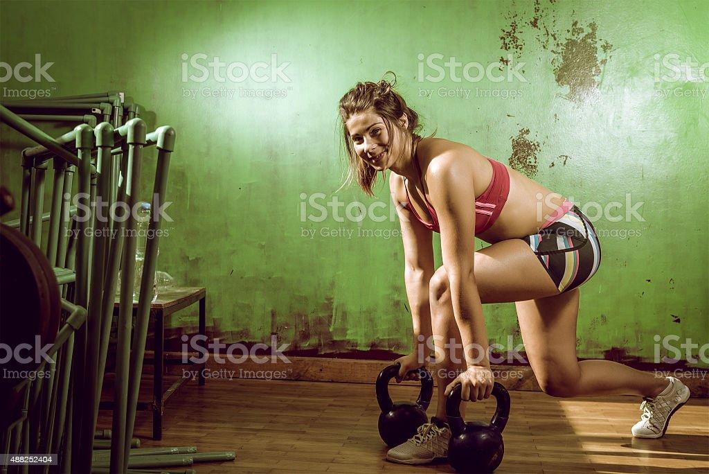 Girl doing lunge exercise stock photo