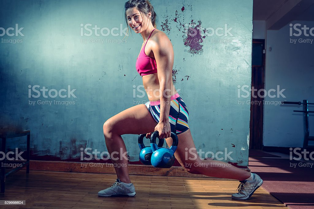 Girl doing lunge exercise stock photo