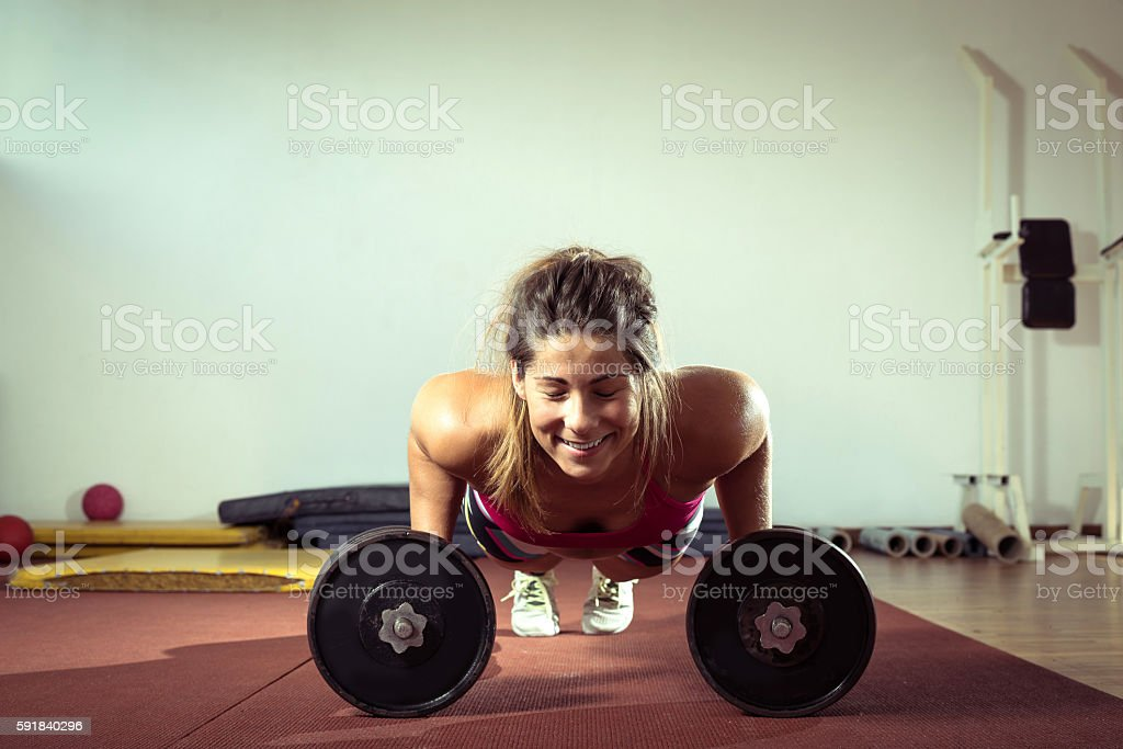 Girl doing push ups with dumbbell - Royalty-free Activity Stock Photo
