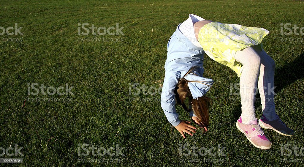 Girl doing somersault stock photo