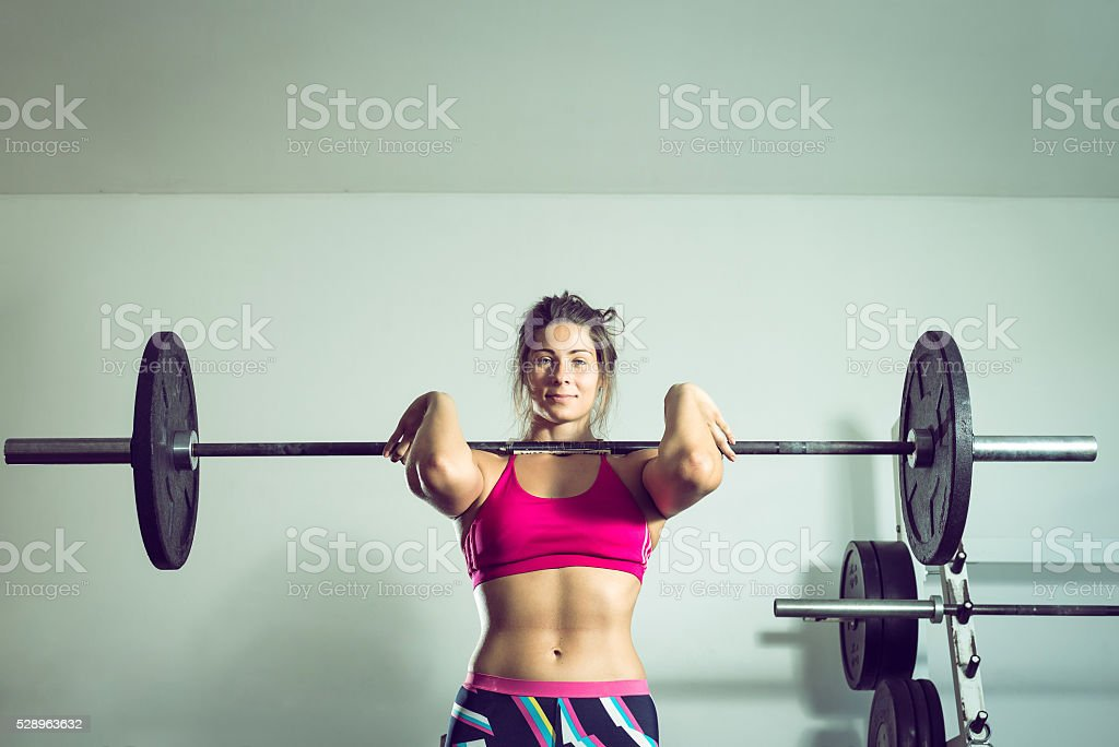 Girl doing weightlifting stock photo
