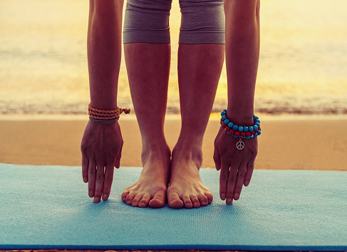 Girl Doing Yoga Exercise On Beach Stock Photo - Download Image Now