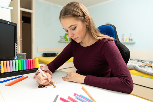 818512928 istock photo Girl drawing a monkey 1203982409