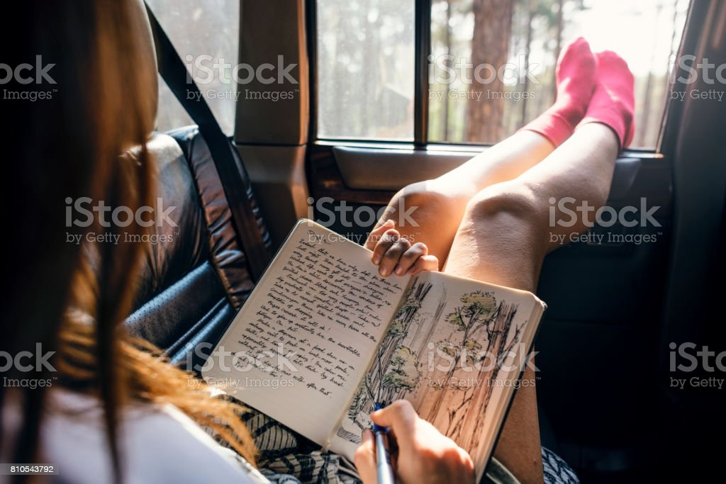 Girl Drawing Pad Road Trip Concept stock photo