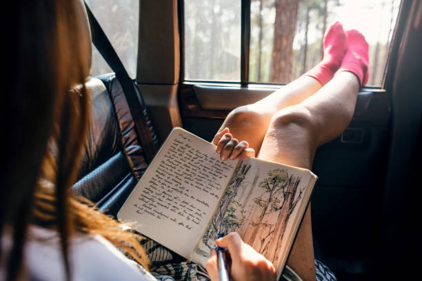 Girl Drawing Pad Road Trip Concept Girl Drawing Pad Road Trip Concept diary stock pictures, royalty-free photos & images