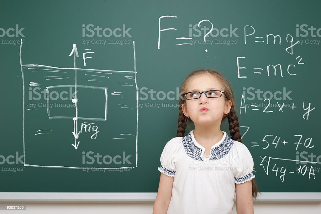 girl drawing physical phenomenon gravity on board stock photo