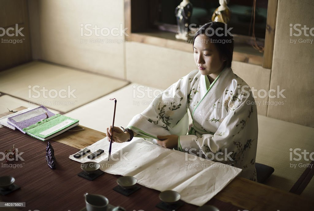 Girl drawing Traditional Chinese Painting royalty-free stock photo