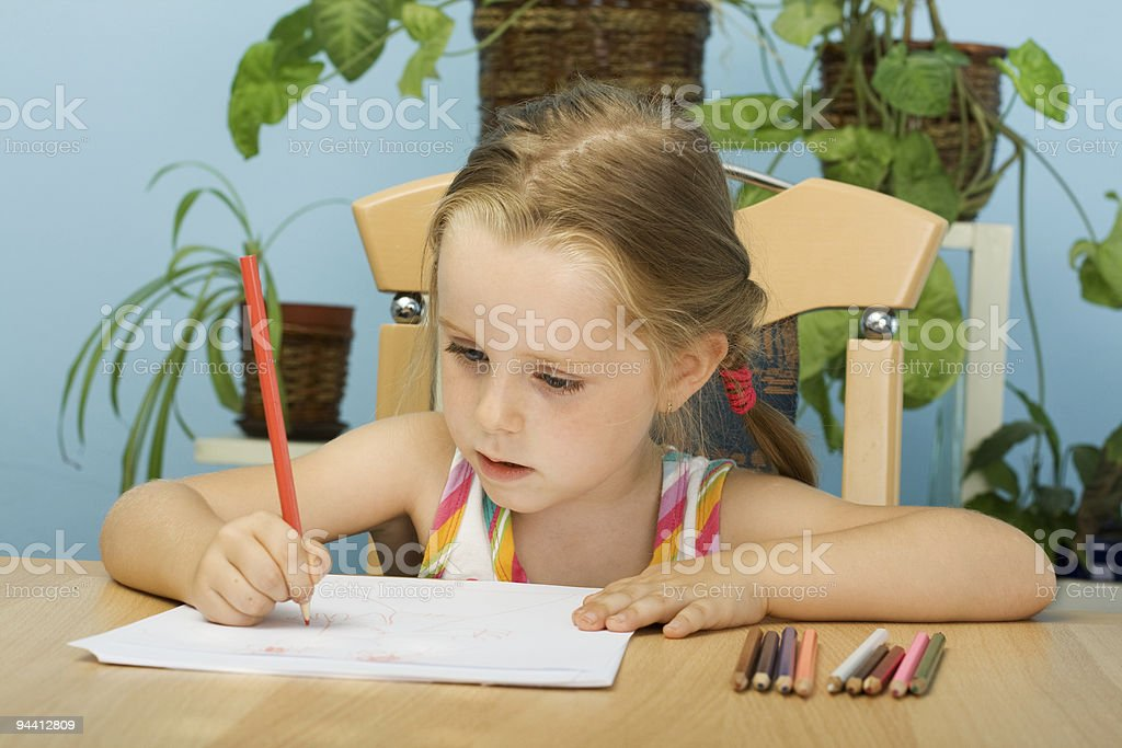 Girl drawing with pencils royalty-free stock photo
