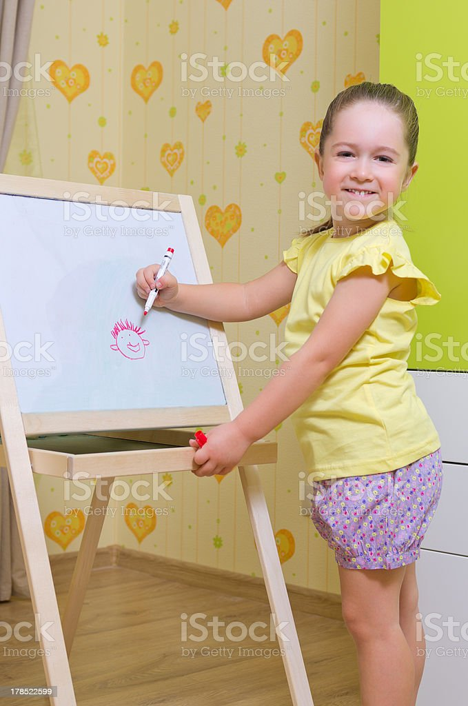 Girl draws a marker on white board royalty-free stock photo
