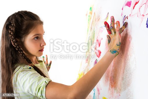 istock Girl draws fingers on paper wall 470642502