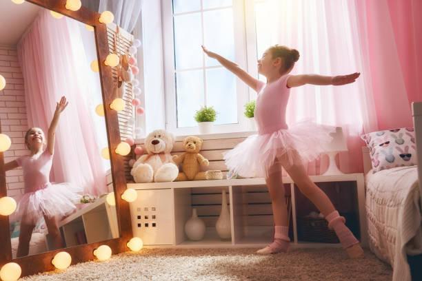 girl dreams of becoming a ballerina - prinzessinnen tutu stock-fotos und bilder