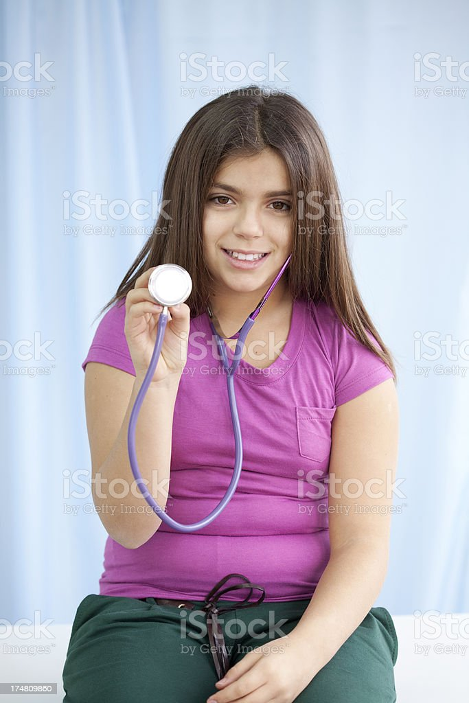 girl dreams to become doctor royalty-free stock photo