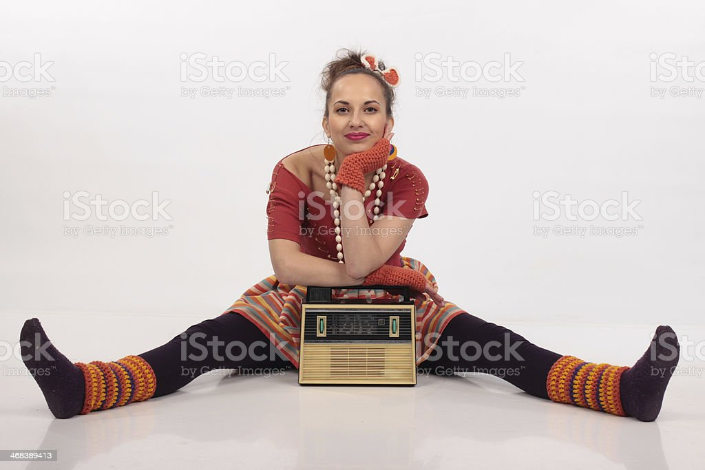 Girl dressed in 80s disco clothing with a boom box stock photo