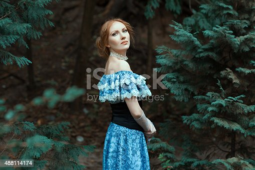 istock Girl dressed in an old-fashioned blue dress. 488114174