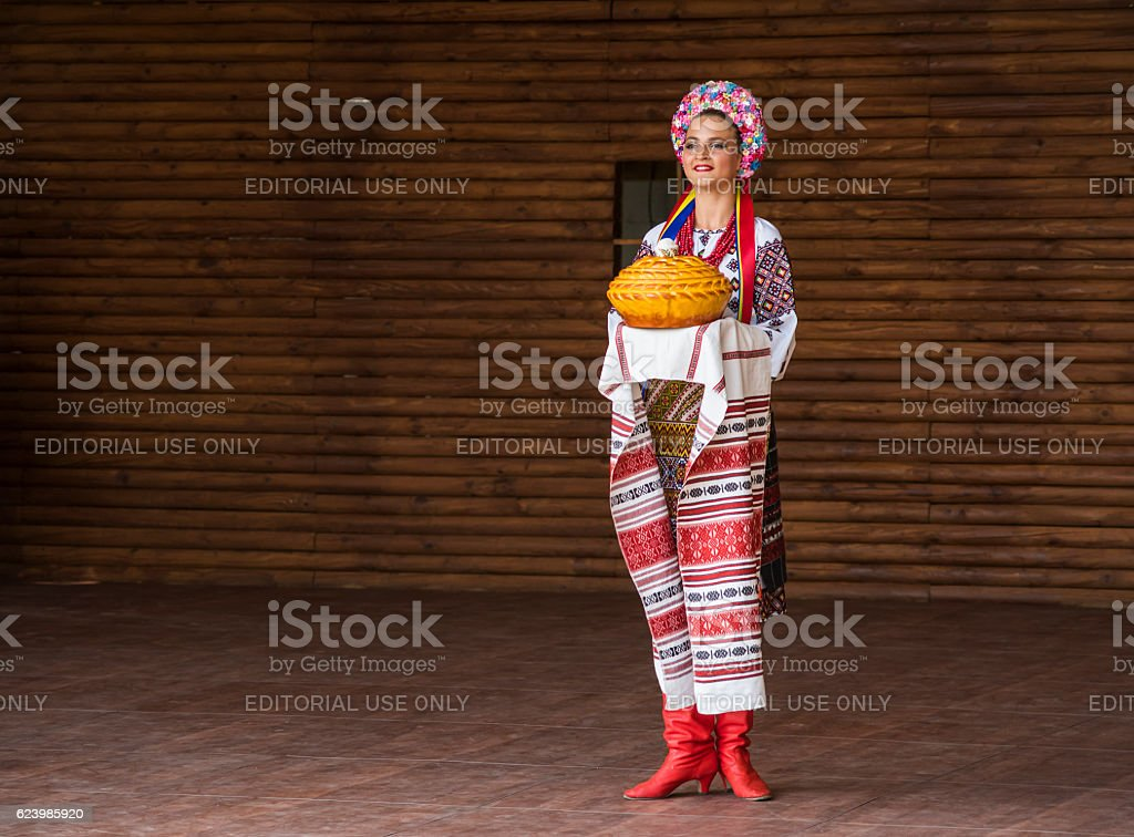 Girl dressed in traditional red Ukrainian embroidered costume stock photo